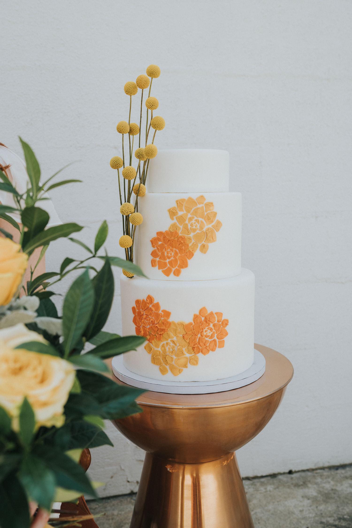 orange and yellow retro wedding cake