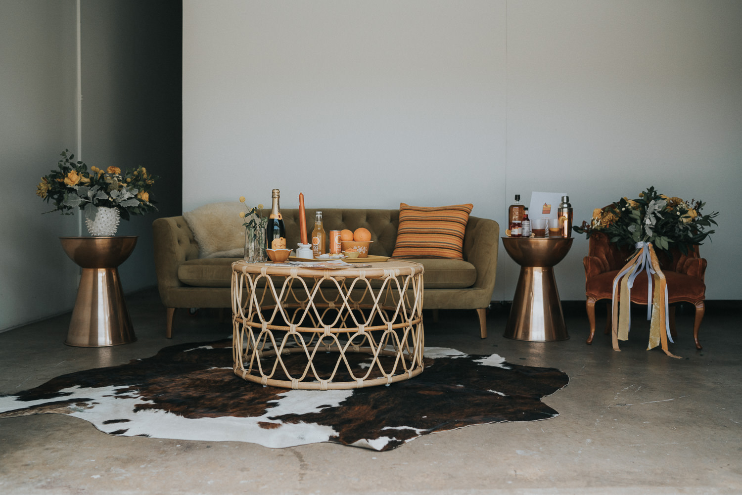 70s Inspired Wedding Lounge with Cowhide Rug and Velvet Couch